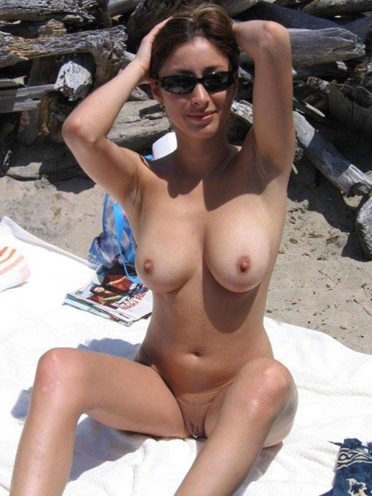 Nude babe with pert boobs expose her clit piercing