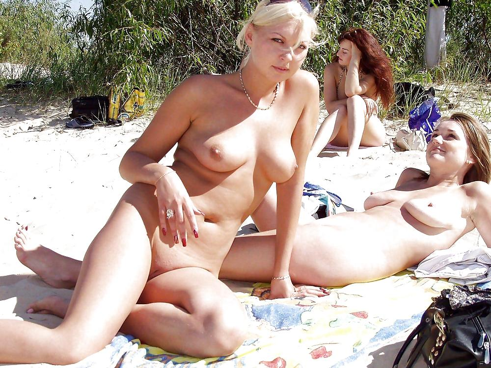Nude babes on exotic beach exposing their appetizing forms