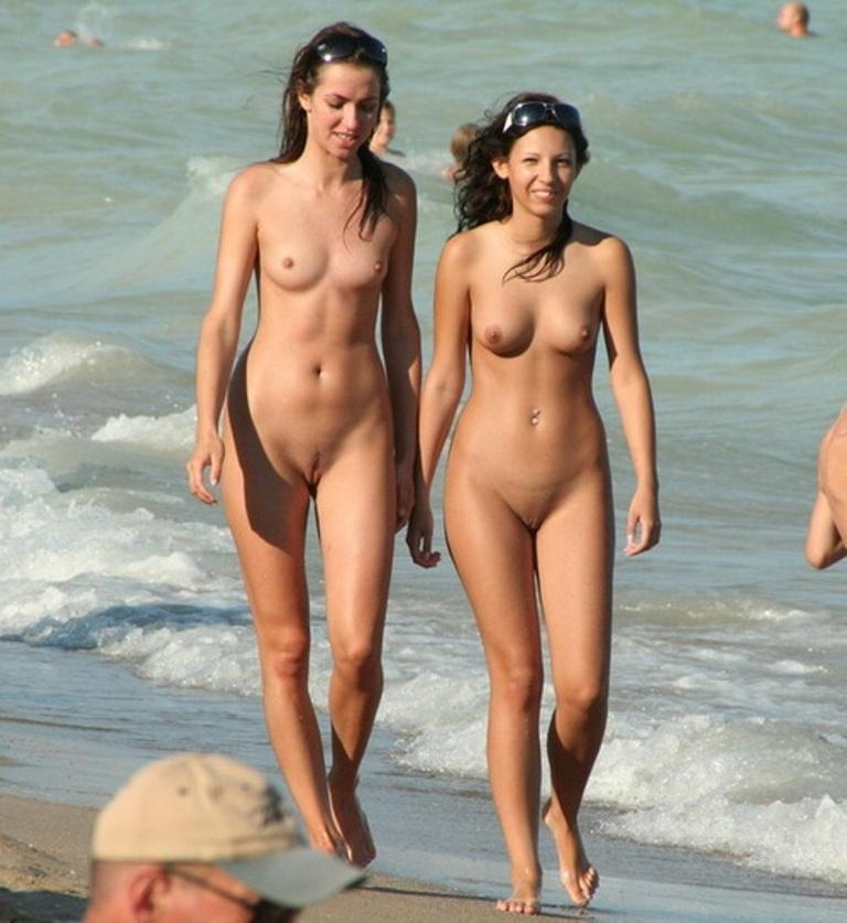 Nude chicks walking on sea shore to be watched by all