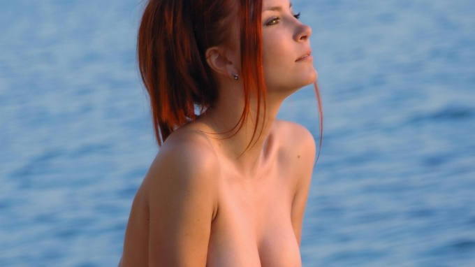Redhead cutie near the sea