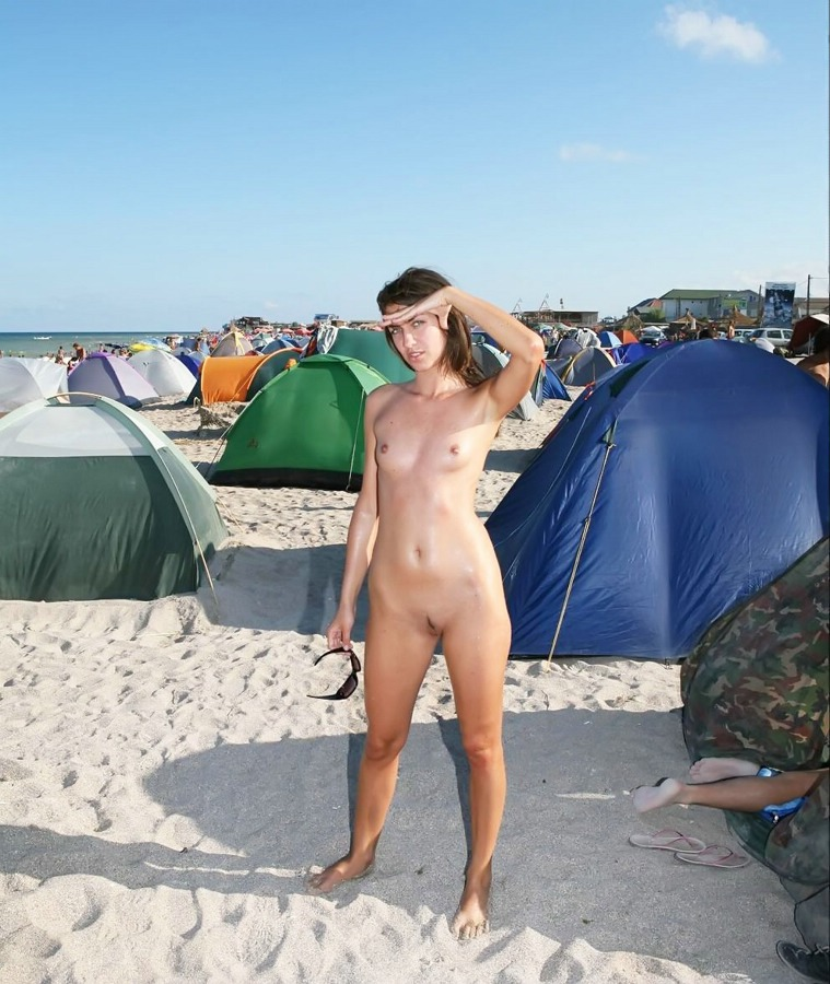 Nudist chick on sunny beach
