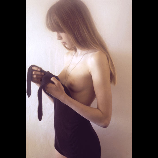 Artistic photo model young and beautiful pose topless wearing a hot black miniskirt