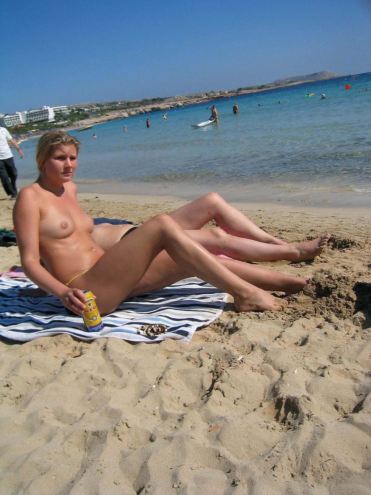 Cute beautiful russian model topless on a nudists beach caught by spy cam