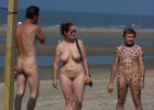 Happy family at the nudist beach man weird tattooed like slave and master