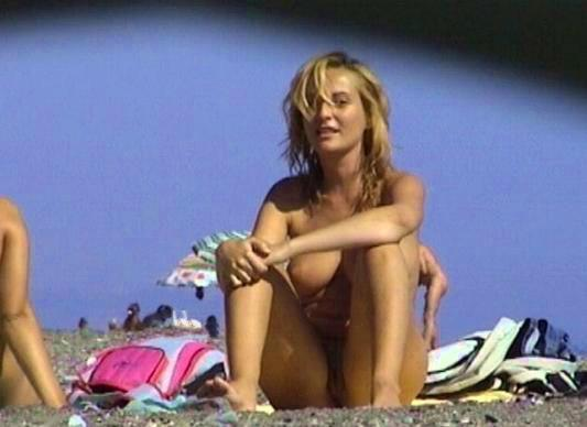 Spy on nude beach caught blond chick with her naughty wild clit