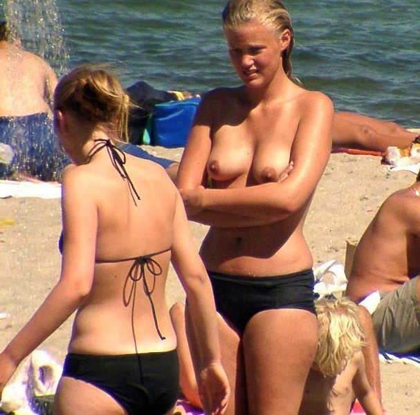 Swedish blond good looking girls caught on summer warm russian beaches exposing their firm naughty topless tits