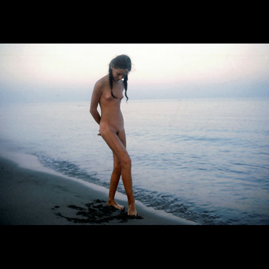 Young girl in the sunset naked at beach with small cute breasts and hairy cunt