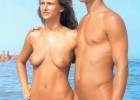 Young nudist couple enjoys the sun and perfect water exposing their naked bodies for curious eyes