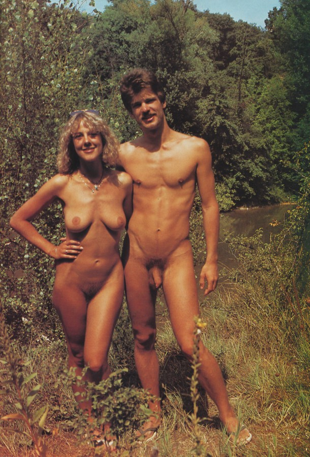 Amateur nudist couple in the nature are very happy and handsome