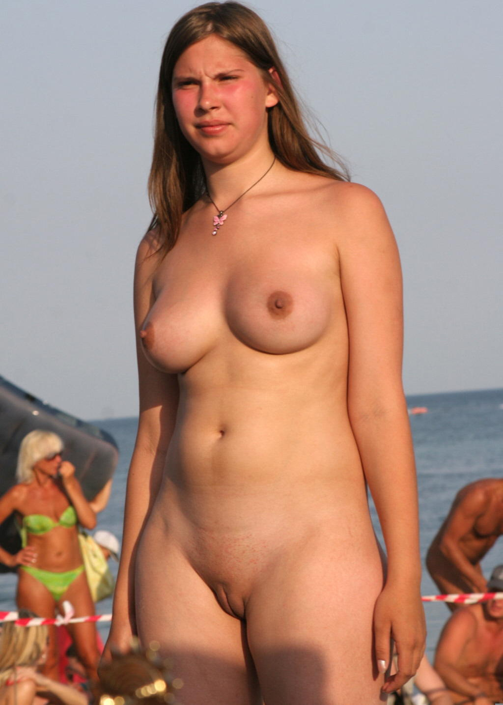 Fatty babe with shaved bald cunt huge breasts and amazing curves at the nudist beach
