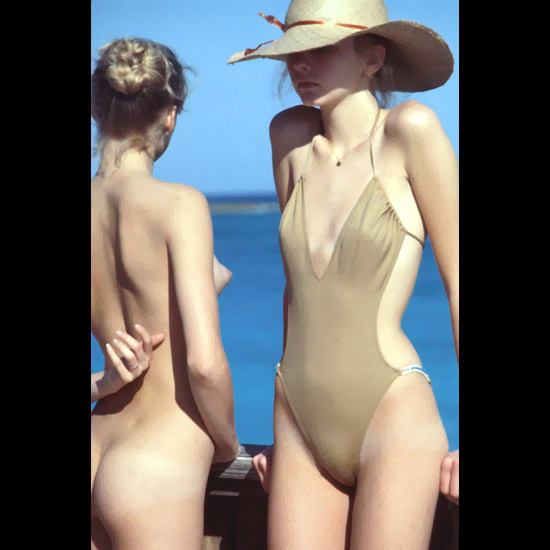Lascivious females with hot butt and perky breasts at the beach in their spare time