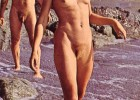 Retro couple in vintage photo at a rocky beach furry and completely naked