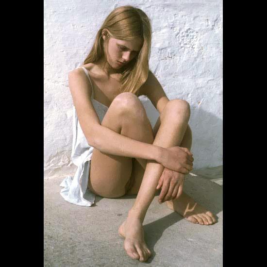 Sad princess in white dress on the sand upskirt wearing no underwear young beautiful body