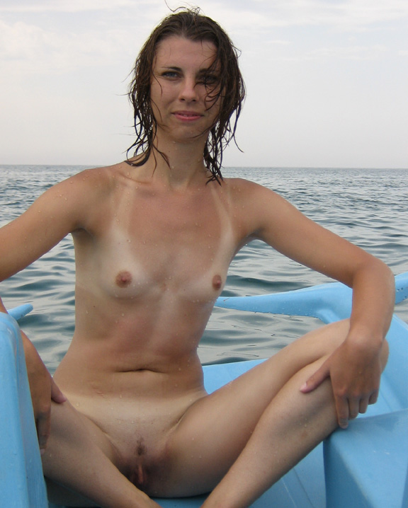 Cute babe on the boat with spread legs posing nude for lover clean cunt on view