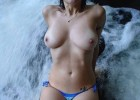 Hot and sexy voluptuous sweet girl caught topless near a mountain falls to cool her excited muff