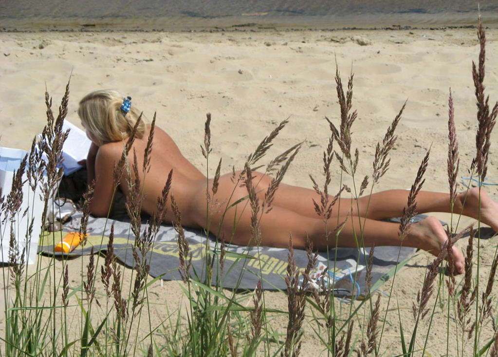 Hot student babe caught naked in the nature while reading a science book