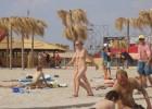 Nude babes caught on wild beach by voyeur photographer
