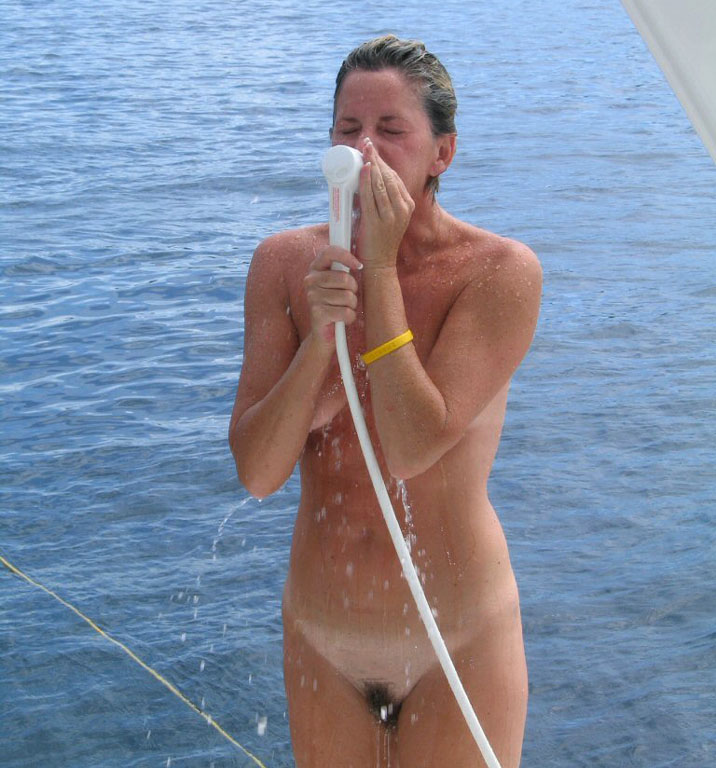 Nude girl have a refreshing cold shower on her parents boat and expose her furry muff