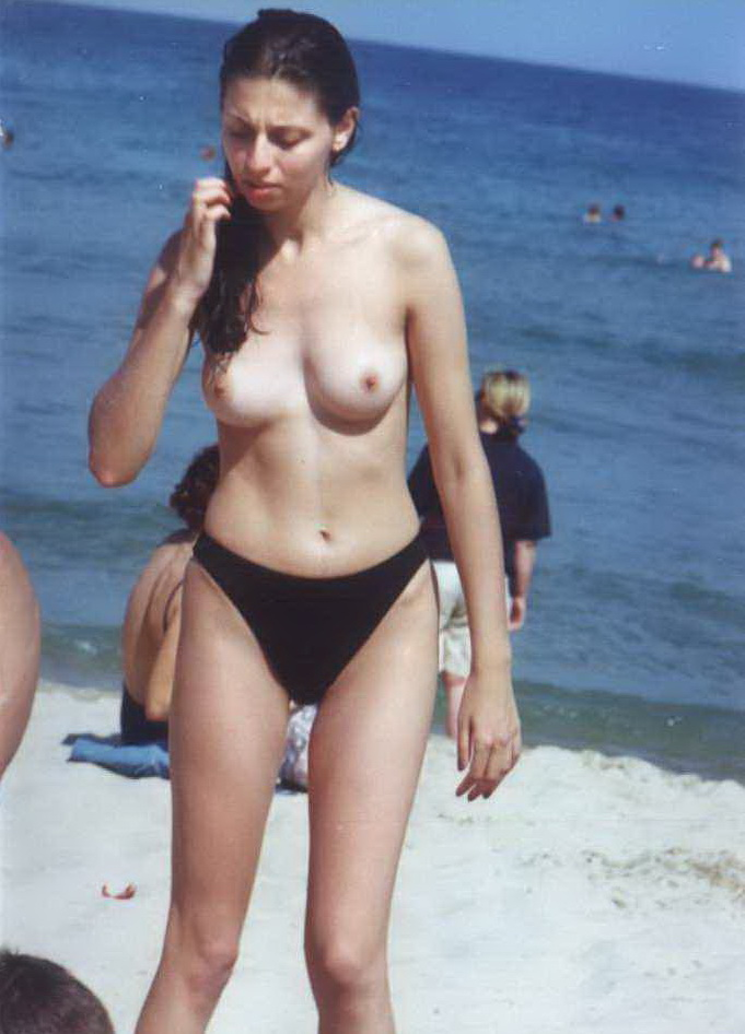 Sad brunette chick topless admires her bf while voyeurs catch her on photo