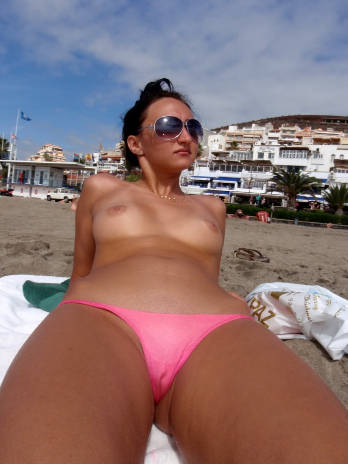 Sunglasses babe topless on wild empty beach expose her tiny cameltoe through pink bikini
