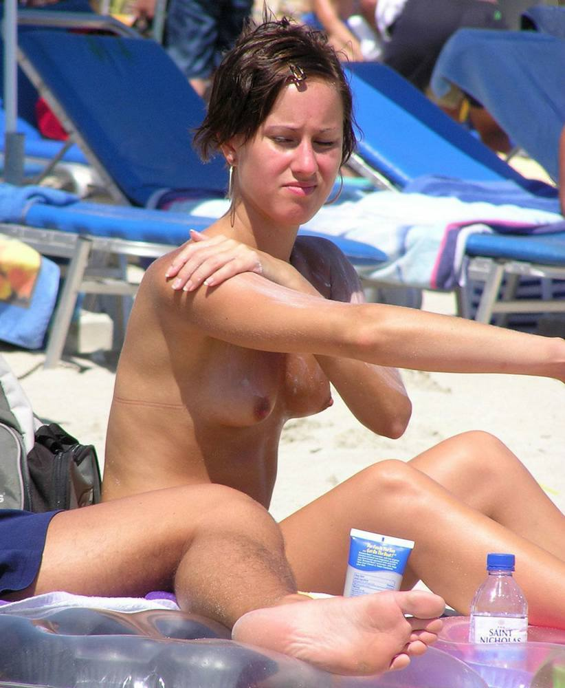 Gorgeous naked chick oiling her naked beautiful body with perky hard nips