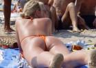 Hot ass tanning at sun and thongs