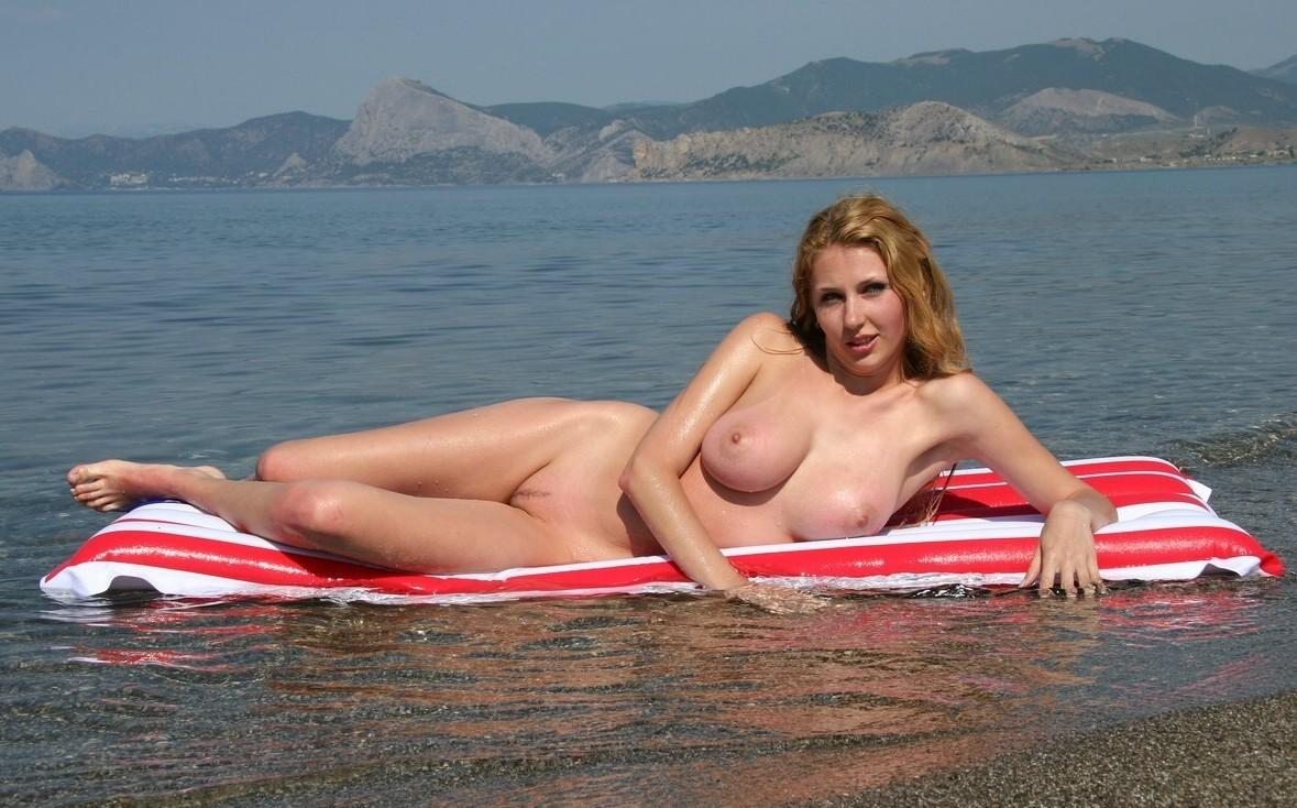 Redhead voluptuous babes posing nude near a beautiful lake view
