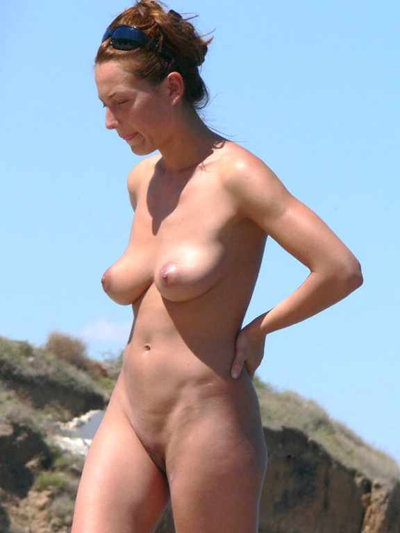Sensual pretty lady caught naked on the beach in nudist camp