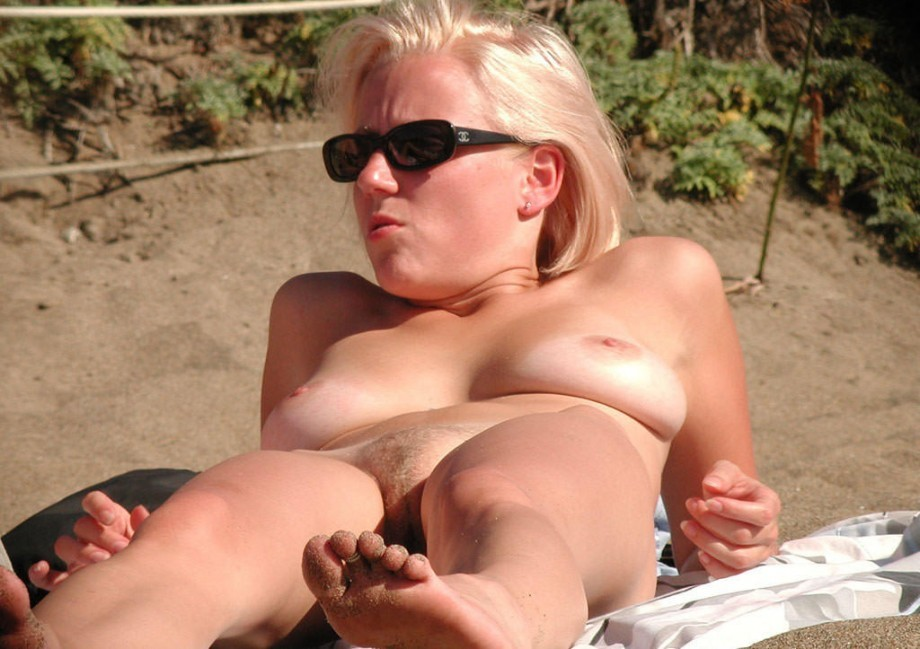Blonde tourist enjoys tanning under the scorching sun