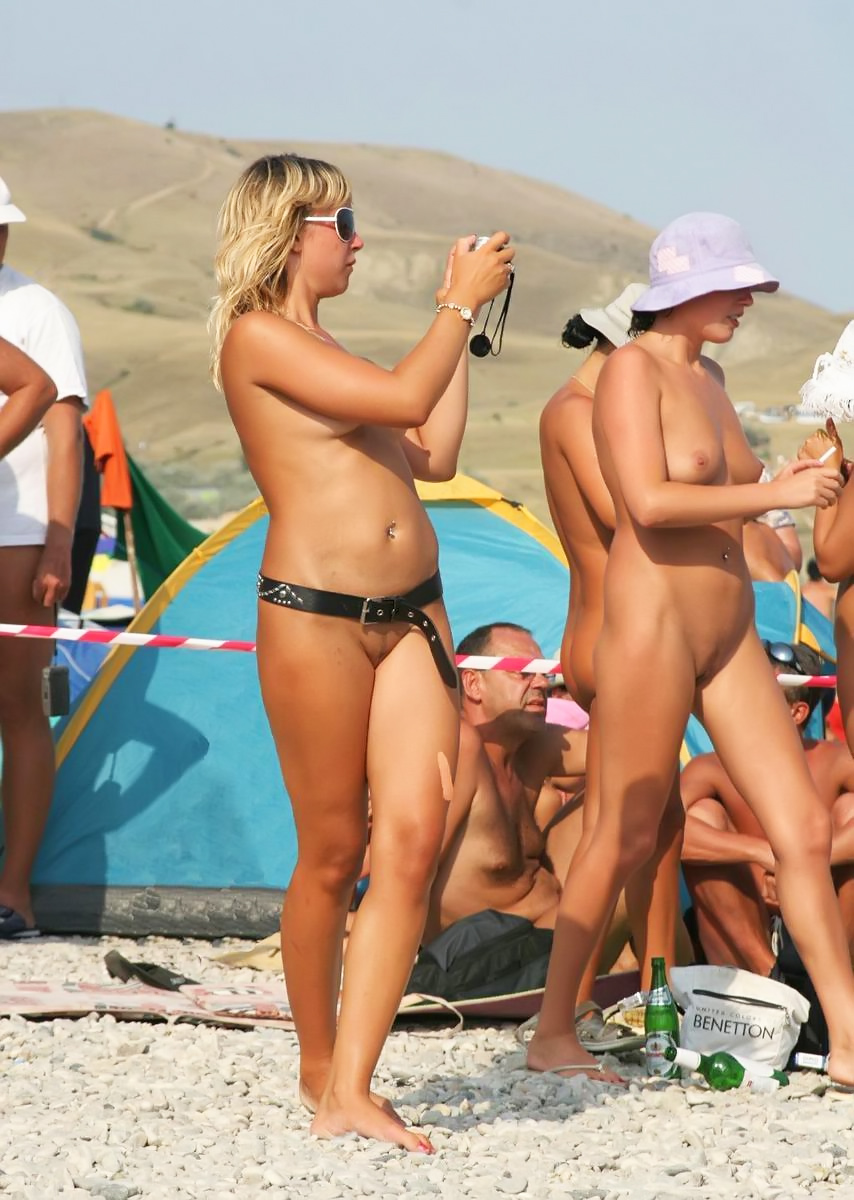 Bunch of tourists practices the art of pure nudism