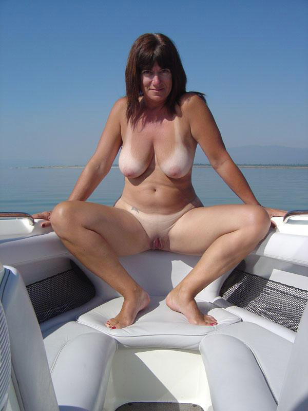 Horny nudist shows her tan lined twat and knockers with pride
