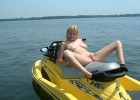 Naughty naked blonde about to do freestyle on jetski with no strings attached