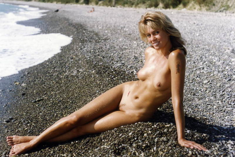 Slutty mistress hunkering and frigging on a secluded area