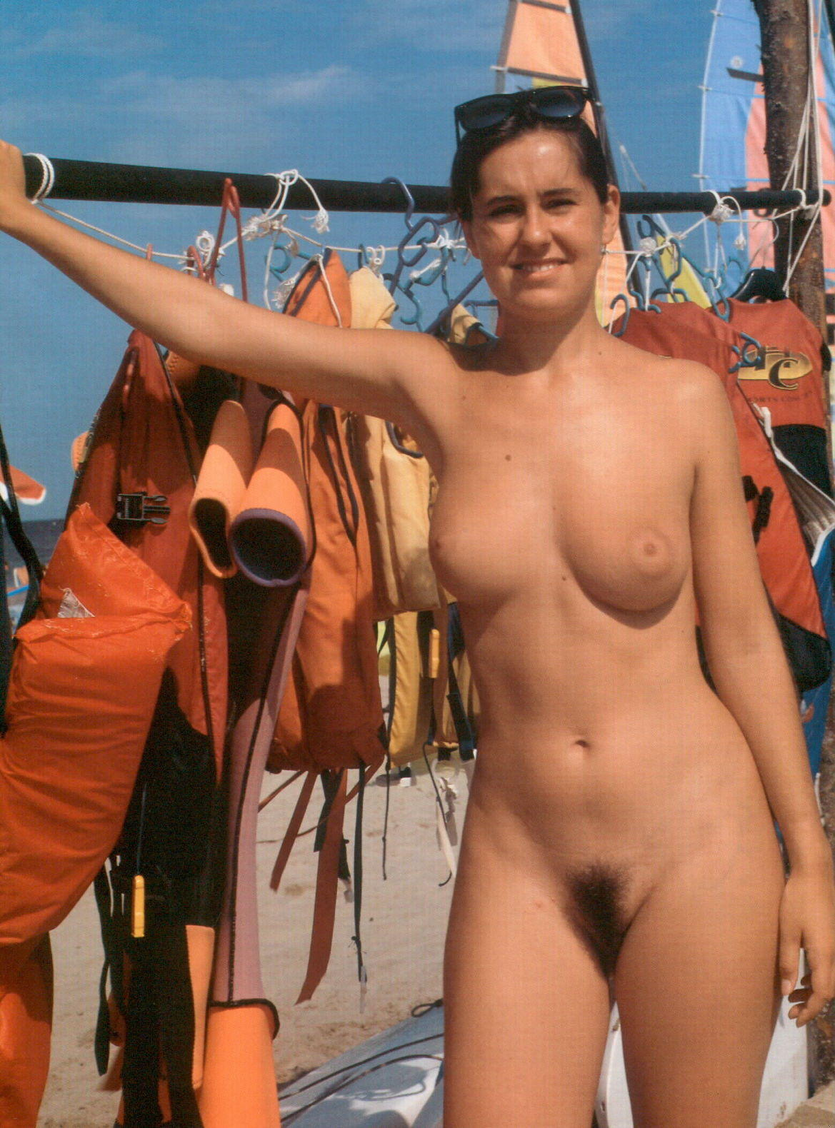 Naked baywatch babe shows boob job and hairy muff