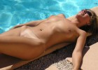 Nude model hang out beside the pool