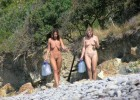 Seductive naked girls out to get fresh water for their camp