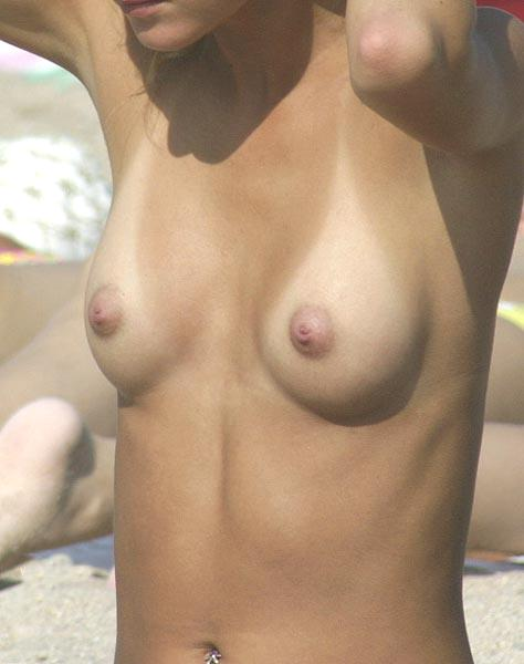 Sweet chick shows off her perky tits
