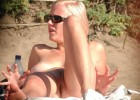 Young naked blonde badly wants to stir her honey pot with her fingers