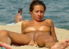 Young nudist gives out the goldmine on the beach