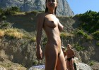 Young nudist loves to feel mother nature on top of the hill