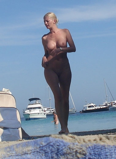 Busty hot blond angel in front of some yachts