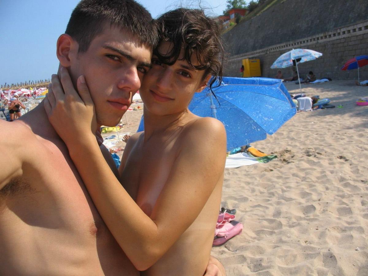 Horny couple tummy rubbing on focused camera