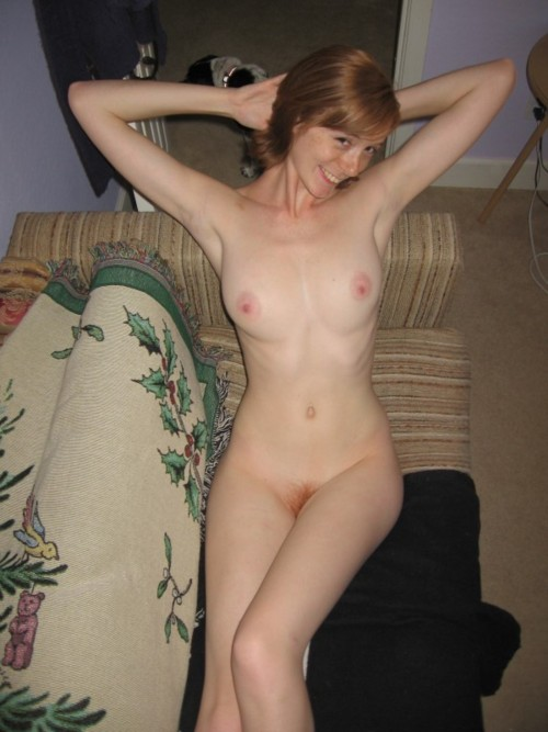 This cute redhead has great boobs and sweet shaved pussy