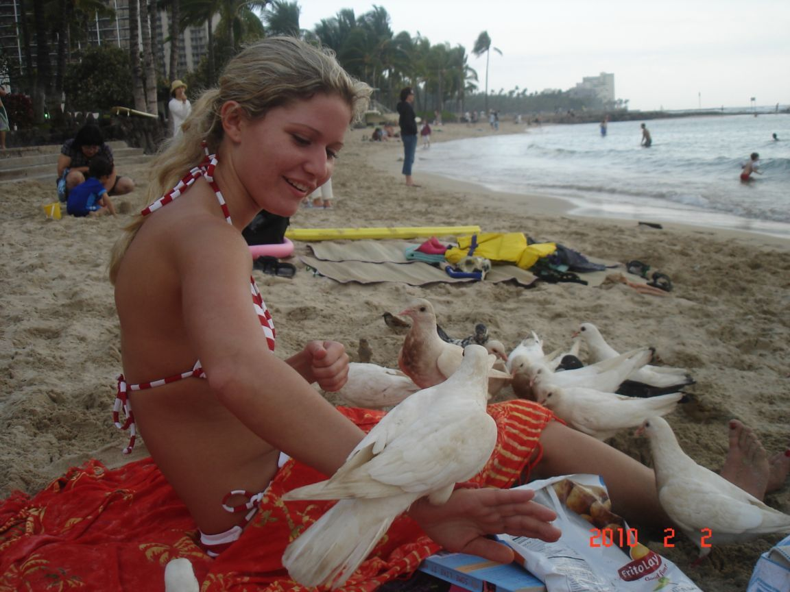 Not only she is beautiful but kind hearted and playing with birds