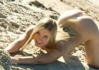 Fantastic blond model playing in the sand