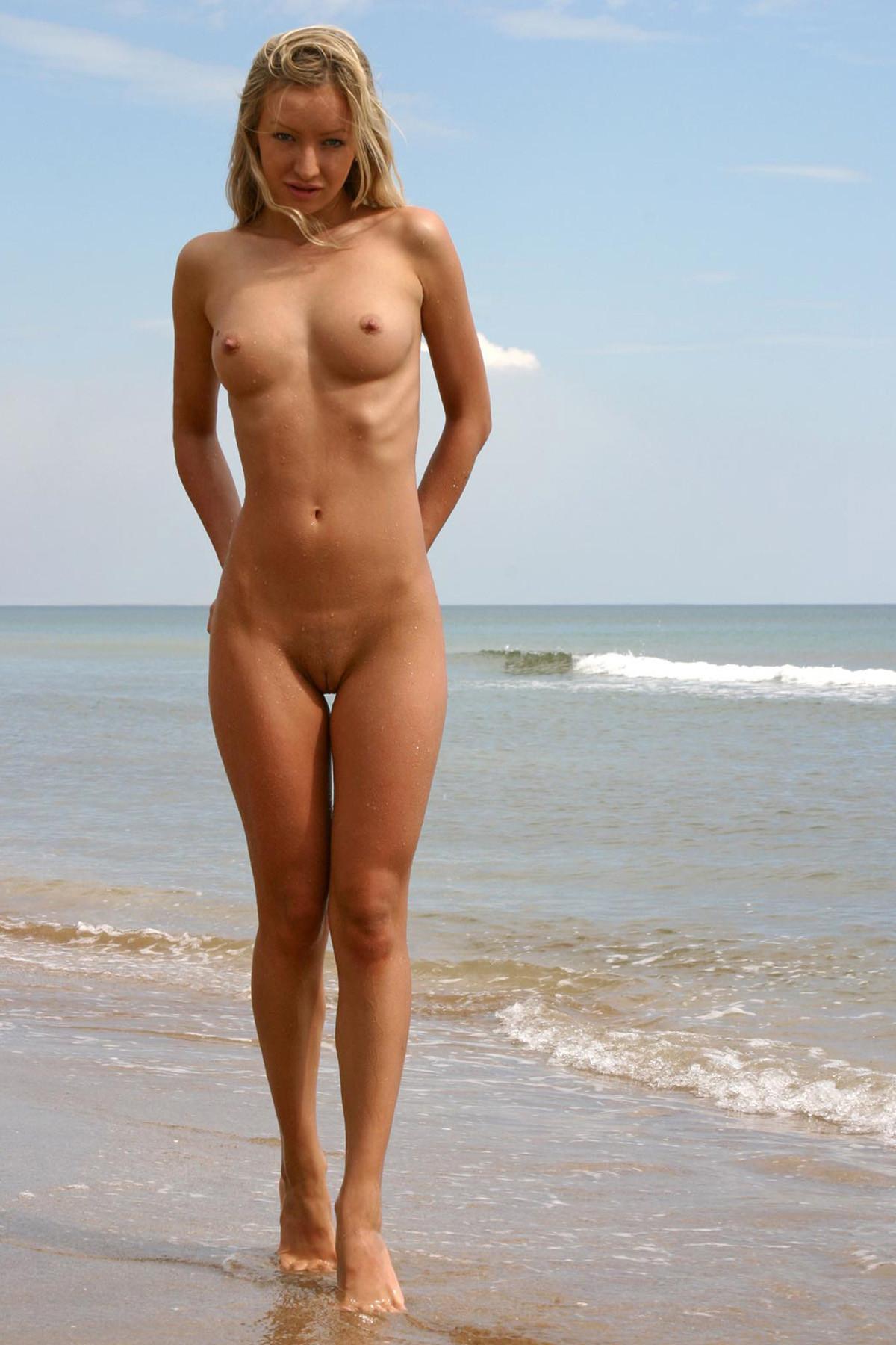 Naked blond babe seems shy