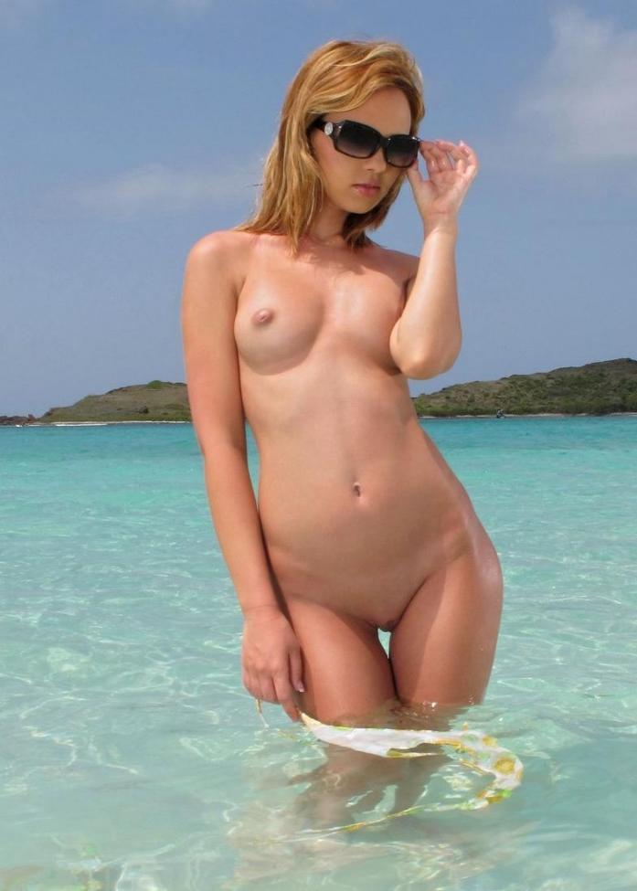 Nude on exotic beach exposing everything