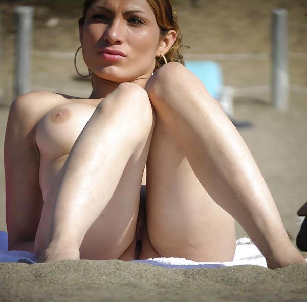 Sunbathing on the beach wearing nothing