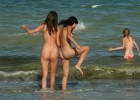 Teens with round asses getting into the sea
