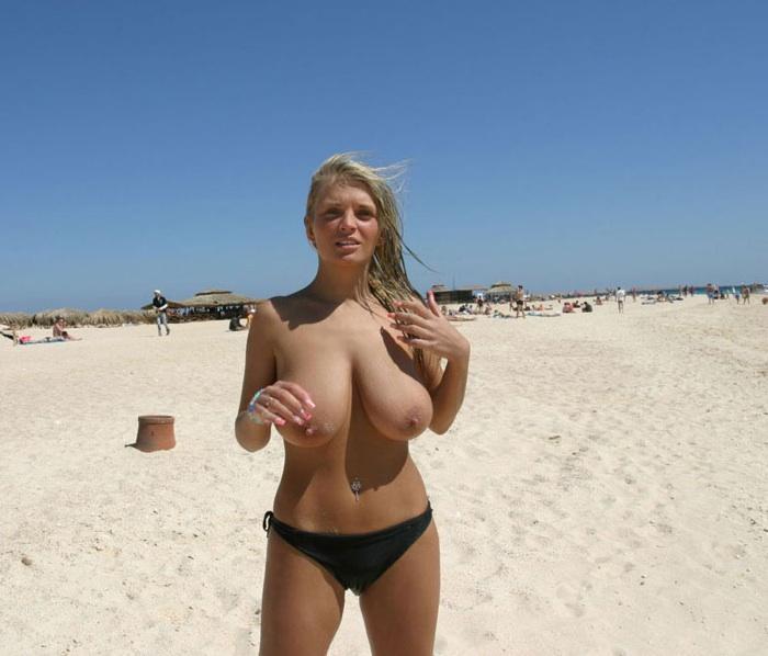Voluptuous hot babe on sunny beach